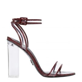 Women's red high heel sandal with clear heel - side view