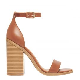 tan high heel ankle strap shoes